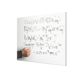 Teacher writing chemical formulae on white board stretched canvas print