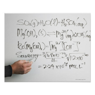 Teacher writing chemical formulae on white board poster