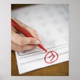 Teacher writing F grade on worksheet Poster