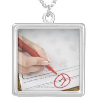 Teacher writing F grade on worksheet Silver Plated Necklace