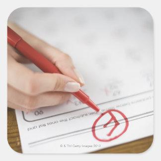Teacher writing F grade on worksheet Square Sticker