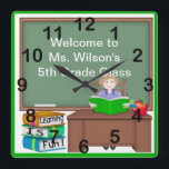 """Teacher&#39;s Chalk Board Female Square Wall Clock<br><div class=""""desc"""">This Teacher&#39;s Chalk Board Female Square Wall Clock features a green background, Female teacher with light brown hair, sitting at her desk with an open book and an apple with a book worm. Next to the desk is a stack of books with text Learning is Fun! Behind her is a...</div>"""