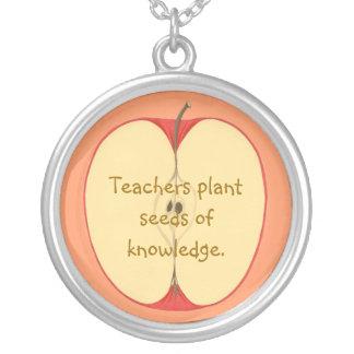 Teachers plant seeds of knowledge, apple necklaces
