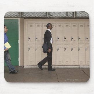 Teachers walking in school corridor mousepad