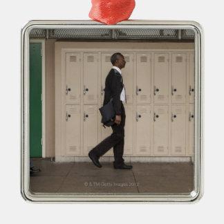 Teachers walking in school corridor christmas ornaments
