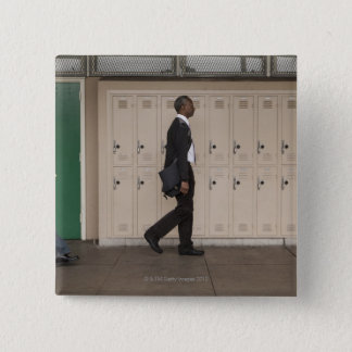 Teachers walking in school corridor pinback button