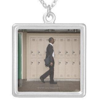 Teachers walking in school corridor silver plated necklace