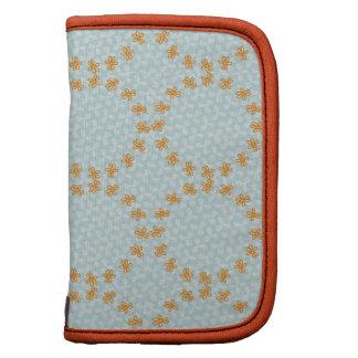 Teal and Orange Simple Flower Pattern Planners