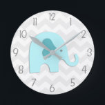 "Teal Aqua Grey Elephant Nursery Wall Clock<br><div class=""desc"">This adorable teal,  aqua and grey elephant on grey and white chevron background design will look perfect in your little one&#39;s nursery or bedroom. Perfect for newborns,  babies,  toddlers or child&#39;s bedroom. Other matching products available in my store!</div>"