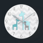 "Teal Aqua Grey Giraffe Nursery Wall Clock<br><div class=""desc"">This adorable teal,  aqua and grey giraffe on grey and white chevron background design will look perfect in your little one&#39;s nursery or bedroom. Perfect for newborns,  babies,  toddlers or child&#39;s bedroom. Other matching products available in my store!</div>"