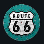 "Teal Green Route 66 sign Dartboard<br><div class=""desc"">Cool,  retro  Teal Green Route 66 road sign. Old black and white vintage,  retro traffic,  road sign on cute    background. Images used on this item are licensed and &#169; Graphics Factory.com</div>"