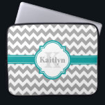 "Teal Grey Chevron Pattern &amp; Moroccan Quatrefoil Laptop Sleeve<br><div class=""desc"">A stylish modern grey chevron zigzag pattern with an elegant, bright teal blue and white quatrefoil nameplate featuring a customizable name and custom monogram. This cool, geometric, fashionable, popular zig zag pattern and personalized name / monogrammed nameplate will make a thoughtful gift for a girly girl that loves chic classy...</div>"