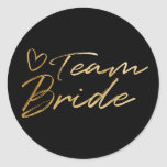 "Team Bride - Gold faux foil sticker<br><div class=""desc"">A very pretty sticker with gold faux foil script for team bride. This will be ideal for bridal showers,  hen parties,  bachelorette parties and other wedding events. This design is available in other titles.</div>"