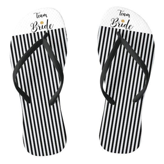 76a7d477c42bc Team Bride Gold Flower Black White Stripes Trendy Flip Flops ...