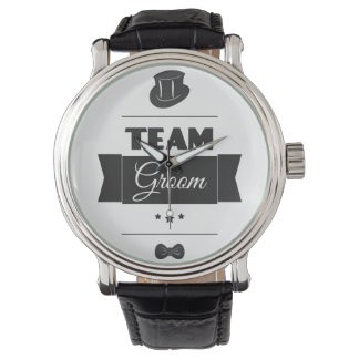 Team groom watches