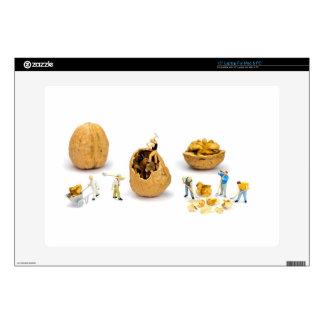 "Team of miniature figurines transporting walnut 15"" laptop decal"