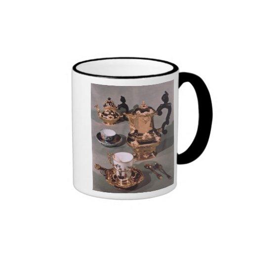 Teapot, sugar bowl, chocolate pot and mug