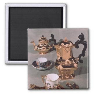 Teapot, sugar bowl, chocolate pot and mug refrigerator magnets