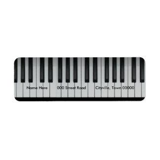 Teclado de piano etiqueta de remite