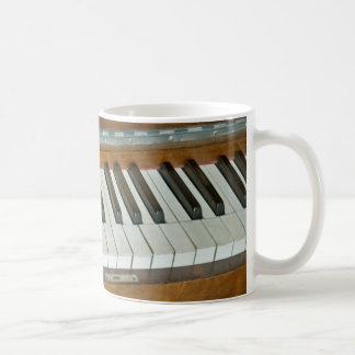 Teclado de piano tazas