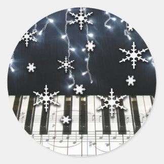 Teclado del copo de nieve del navidad del piano etiqueta redonda