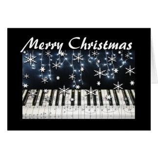 Teclado del copo de nieve del navidad del piano tarjeta de felicitación
