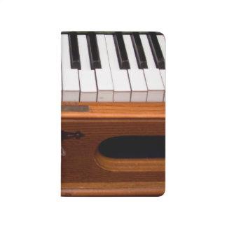 Teclado del órgano cuadernos grapados