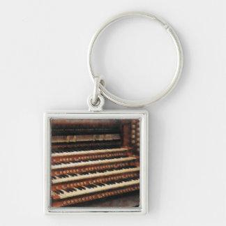 Teclado del órgano llavero cuadrado plateado