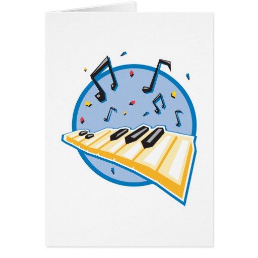 teclado y diseño de las notas de la música tarjeta