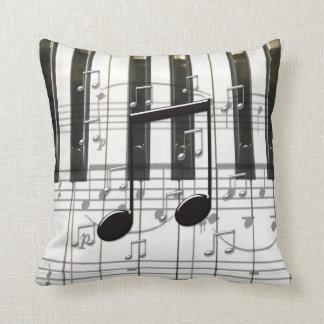Teclado y notas de piano almohada