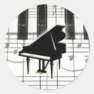 Teclado y notas de piano de cola pegatina redonda