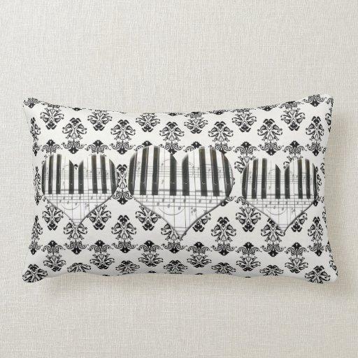Teclado y notas de piano del corazón del damasco cojín