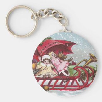 Teddy Bear and Dolls on Sled Vintage Christmas Keychain