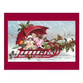 Teddy Bear and Dolls on Sled Vintage Christmas Postcard