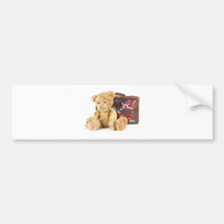 teddy bear and vintage old suitcase with world sti bumper sticker