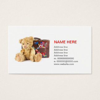 teddy bear and vintage old suitcase with world sti business card