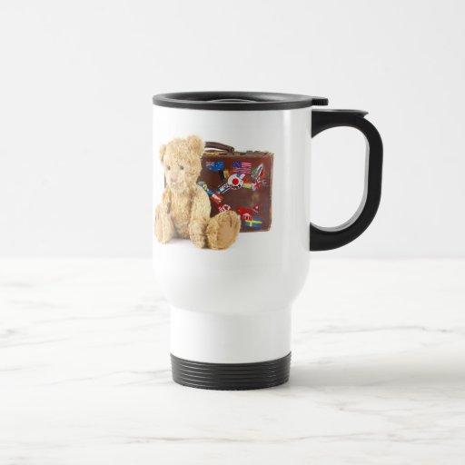 teddy bear and vintage old suitcase with world sti mug