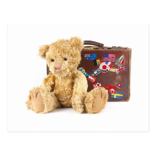 teddy bear and vintage old suitcase with world sti post card