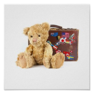 teddy bear and vintage old suitcase with world sti poster