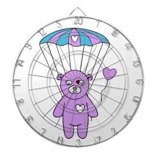Teddy bear dartboard with darts