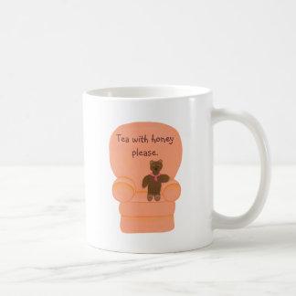 Teddy bear in chair, tea with honey please, mugs
