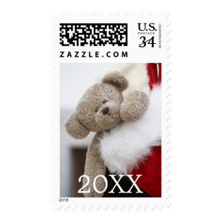 Teddy bear in Christmas stocking Postage