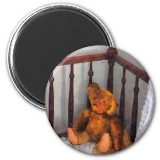 Teddy Bear in Crib 2 Inch Round Magnet