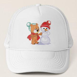 Teddy bear making a snowman trucker hat