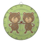 Teddy bear on plain pastel green. dartboard with darts