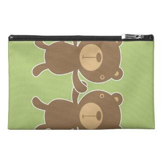 Teddy bear on plain pastel green. travel accessory bag