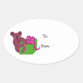 Teddy Bear Opening a Present Oval Sticker
