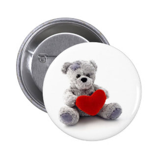 Teddy Bear Toy Holding A Heart On White Background Button