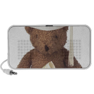 Teddy bear wearing mortarboard and with crayon iPod speakers