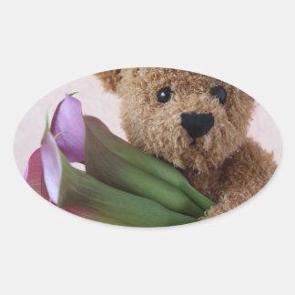 Teddy bear with calla lilies oval sticker